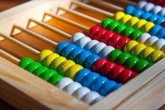 五颜六色的木算盘 库存照片