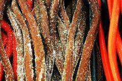 五颜六色的欧亚甘草糖果在10月,背景 免版税库存照片