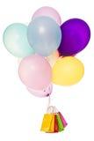 五颜六色的气球,全部购物袋,隔绝在白色 免版税库存照片