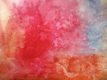 五颜六色的水彩污点抽象背景和模糊的颜色的橙红和蓝色 手工制造在纸 免版税图库摄影