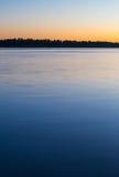 五颜六色的河日落 库存照片