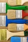 五颜六色的油漆刷木头 库存照片