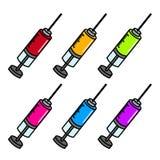 五颜六色的注射器 免版税库存图片