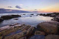 五颜六色的海洋日落 库存图片