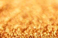 五颜六色的火花和打击美妙的金黄bokeh 库存图片