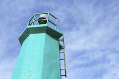 五颜六色的灯塔在船坞 库存图片