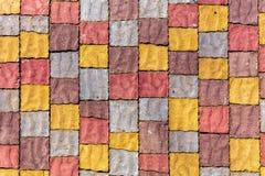 五颜六色的石块墙壁 免版税库存图片