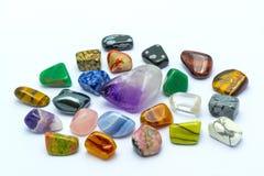 五颜六色的石头在空白背景中 免版税库存图片