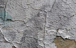 五颜六色的破裂的油漆背景在墙壁上绘了被绘 库存照片