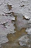 五颜六色的破裂的油漆背景在墙壁上绘了被绘 免版税库存图片