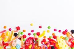 五颜六色的糖果、果冻和冰棍流行音乐 免版税库存照片