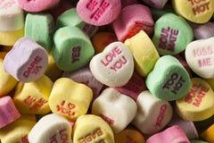 五颜六色的糖果交谈心脏 图库摄影