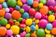 五颜六色的糖果的三个不同范围 库存图片