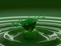 五颜六色的绿色流体飞溅与小滴和波浪的 库存照片