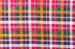 五颜六色的缠腰带织品背景 库存图片