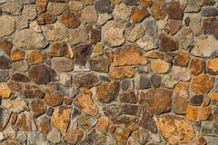五颜六色的老石纹理墙壁 免版税库存图片