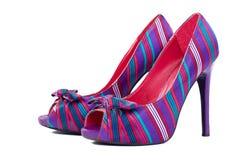 五颜六色的脚跟高对穿上鞋子白色 库存照片