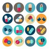 五颜六色的药片和胶囊象 免版税库存图片