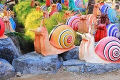 五颜六色的蜗牛雕象 库存照片