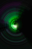 五颜六色的螺旋辐形行动背景 库存图片