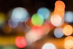 五颜六色的街道交通bokeh背景 免版税库存照片