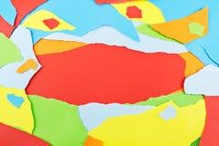 五颜六色的被撕毁的纸背景 免版税库存图片