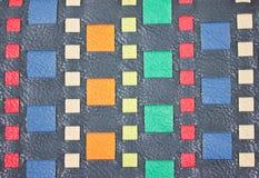 五颜六色的被编织的假皮革。 库存照片