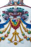五颜六色的装饰和雕刻在Boudhanath stupa,加德满都,尼泊尔 库存照片