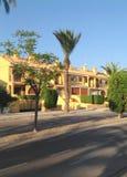 五颜六色的西班牙二层楼的房子门面  图库摄影