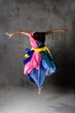 五颜六色的跳舞礼服女孩现代年轻人 库存图片