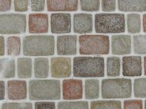五颜六色的铺路石背景 库存图片