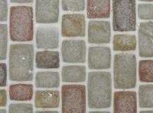 五颜六色的铺路石背景 免版税图库摄影