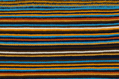 五颜六色的镶边围巾 织品的纹理 库存图片