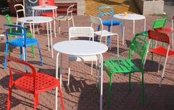五颜六色的露台椅子 免版税图库摄影