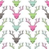 五颜六色的鹿头无缝的样式 库存图片