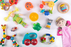 五颜六色的婴孩玩具品种在白色的 顶视图 免版税库存照片