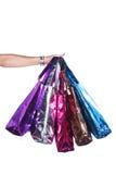 五颜六色的购物袋用手 库存图片