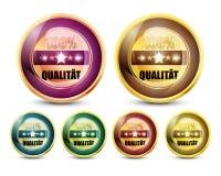 五颜六色的100% Qualitat按钮集 免版税库存图片
