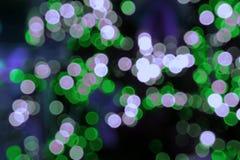 五颜六色的bokeh通过玻璃背景 免版税图库摄影