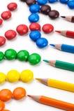 五颜六色的candys和penciles 图库摄影