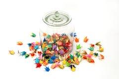 五颜六色的origami鸟无危险玻璃瓶子 免版税库存图片