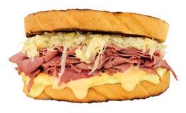 五香熏牛肉在白色背景隔绝的Reuben三明治 库存照片