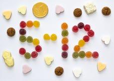 五12月拼写用假日糖果 免版税图库摄影