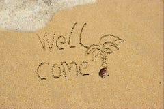 井在沙子海滩来。 图库摄影