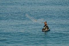 巴亚尔塔港墨西哥渔夫和他的狗 库存照片