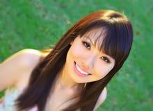 亚洲中国女孩绿色公园 免版税库存图片