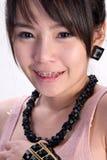 亚洲人支撑女孩性感的微笑 库存图片