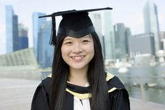 亚洲人毕业生愉快的夫人 库存照片