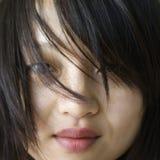 亚洲俏丽的妇女年轻人 免版税库存照片