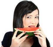 亚洲吃女孩西瓜年轻人 免版税库存图片